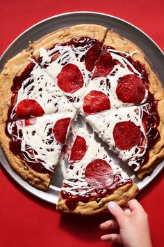 """NYT Cooking: You like chocolate chip cookies. You like pizza. What could be better than a giant chocolate chip pizza cookie? If your answer is, """"pretty much nothing,"""" we'd say you're 100% right. This Instagram-worthy treat starts with a batch of <a href=""""https://cooking.nytimes.com/recipes/1015819-chocolate-chip-cookies"""">our famous chocolate chip cookie dough</a> (with a smidge of cornstarch to keep t..."""