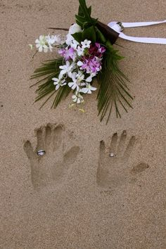 Hands in the sand. Remember to use the damp sand, not the real dry stuff where rings disappear forever.