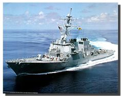 Wall posters are an instant option to enhance the visual appeal of your entire place. This wonderful wall poster transforms the boring dull walls of your living room into a charming, elegant space. It captures the image of USS Cole Guided Missile Destroyer Carrier Navy Ship running into ocean is sure to attract lot of attention. What are you waiting for? Grab this wall art which offers you amazing quality product with wonderful color accuracy. Make your order today!
