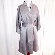 Vertigo Paris Evening Coat Silver evening coat from Vertigo Paris. Kimono style with nod to an obi in the back, and origami style 3/4 length sleeves. Belted with front snap closure. Slit pockets, fully lined. 55% cotton, 40% polyester, 5% spandex. Silver/gray with slight sheen. NWT.  Trades, holds or PP.   Reasonable offers will be considered.  Lowballs will be declined/ignored.  Use offer button to discuss price. Vertigo Paris Jackets & Coats