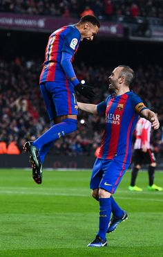 Neymar Jr. of FC Barcelona celebrates with his team mate Andres Iniesta of FC Barcelona after scoring his team's second goal from the penalty spot during the Copa del Rey round of 16 second leg match between FC Barcelona and Athletic Club at Camp Nou on January 11, 2017 in Barcelona, Catalonia.