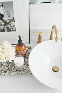 Bathroom Makeover with Gold Faucets designed by Kristin Cadwallader via Bliss at Home
