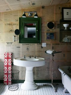 bathroom, old newspapers on the wall.