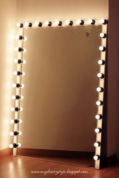 DIY Hollywood-style mirror with lights! Tutorial from scratch. Would be great in E's Bathroom
