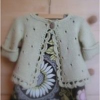 Who could resist this one with it's sweet eyelets and crocheted edge? Knit all in one piece ---No seams ! Yea!
