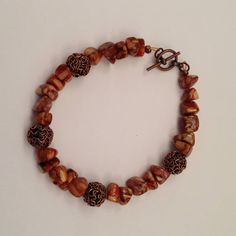 Sharing Kathi Demaret - This coppery beaded bracelet is made from Copper Mosaic shell chips and Copper Metal Beads, with a simple Toggle clasp. It is very lightweight to wear. The total length is 8 1/2 inches, easily fitting a 7 1/2 inch wrist, but can be modified to fit a smaller wrist.  $20 https://www.facebook.com/lunaessence/posts/10205450185466658