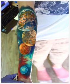 Space - the final frontier. Thanks to the launch of the Hubble Space Telescope 25 years ago, space is no longer just a thing we get to see in science fiction movies. These 13 beautiful tattoos perfectly embody our fascination with the great unknown that is outer space.The depth of color in this vibrant space sleeve is truly incredible, as is the deal of the planets and the galaxy.