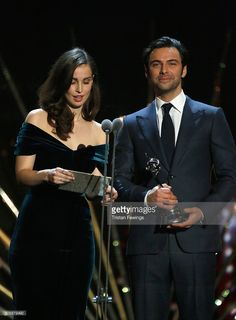Heida Reed and Aidan Turner present the award for Drama at the 21st National Television Awards at The O2 Arena on January 20, 2016 in London, England.