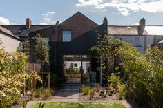 Two storey extension to north-facing terraced house. Materials are a play of contrasting textured brick and metal cladding. A dramatic, sharp angled mono-pitched roof allows clerestorey light from west.