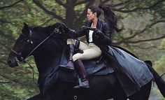 Angelina Jolie riding side-saddle on a Friesian in Tomb Raider.