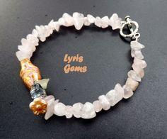 Rose Quartz Bracelet Fertility Bracelet Goddess Bracelet with Czech flowers by Lyrisgems by lyrisgems on Etsy https://www.etsy.com/listing/232958844/rose-quartz-bracelet-fertility-bracelet