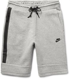 Cut in a straight-leg silhouette to offer unrestricted movement, these Nike shorts are ideal for outdoor workouts. They are constructed from the brand's soft cotton-blend Tech Fleece, and are specially engineered to seal in body heat without adding bulk. On active days, wear yours with a lightweight shell jacket and sporty sneakers. Fits true to size. Take your normal size Straight-leg, mid-rise style These shorts are adjustable at the waist Light-grey cotton-blend Tech Fleece Elasticated…