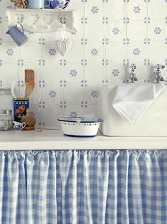 Antic Blanco Delft Decor // Very similar to some of the Ponchon tiles // And look at the curtain below the counter! // Whoa, the busy one is apparently £531.95/m2, which makes the Ponchon look cheap! The plainer one is £88.76/m2. Why the huge difference?