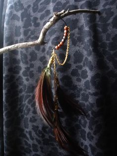 Whiskey Shot- Wood beaded ear cuff with feathers and gold chain $25.00