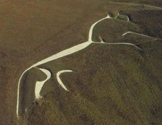 Ancient England - The Ancient Cultures of Britain | The White Horse is one of the most iconic images of Ancient Britain. It sits on the northern face of the Berkshire Downs. Measuring 110 x 38.5 meters, it is the second largest chalk figure in the British Isles, and possibly the oldest; new dating techniques indicate that the horse was constructed around 8-700 B.C.
