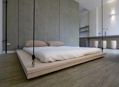 """""""La ristrutturazione di un piccolo appartamento nel pieno centro storico di Taormina è l'occasione per riflettere sul valore dello spazio. Un letto sopraelevabile scompare nel soffitto pronto a cedere lo spazio necessario alle attività..."""