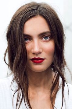 Tousled waves, fresh face and matte red lips. @thecoveteur
