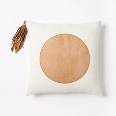 "Commune Circle Shape Pillow Cover | west elm, tan leather applique and tassel, 100% linen natural, 18""sq, $29 on sale"