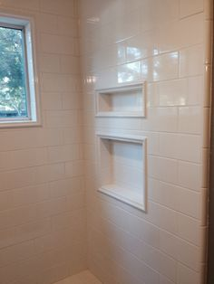 Shower, before doors installed. I trimmed out niches and window with pretty tile detail. I chose an understated look, as opposed to inside niche in contrasting tile.