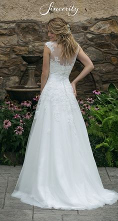 Feel dreamy in this sweetheart A-line wedding gown. Embroidered lace adorns the sweetheart neckline and cascades into the flowing tulle skirt. Plus Size Brides, Plus Size Gowns, Elegant Wedding Dress, Designer Wedding Dresses, Bridal Gowns, Wedding Gowns, Justin Alexander Bridal, Gown With Jacket, Sincerity Bridal