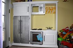 Play Kitchen from old entertainment center!
