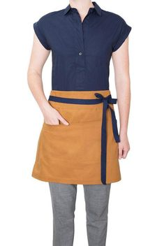 Inspired by a trip to the mountains of Colorado, we designed this crossback apron with a sturdy 10 oz Duck Canvas in a rich earthy tone reminiscent of the beautiful landscape. This apron is serious business! Cafe Uniform, Hotel Uniform, Waitress Outfit, Cocktail Waitress, Waist Apron, Cafe Bistro, Uniform Design, Jean Shirts, Who What Wear