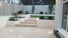 Garden Renovation in Dublin. A completed project featuring our Limestone Ivory Outdoor Porcelain complemented with stunning, low-maintenance artificial grass. We are loving the split-level! Back Garden Landscaping, Sloped Garden, Small Backyard Patio, Sloped Backyard, Garden Tiles, Patio Tiles, Outdoor Tiles, Artificial Grass Ideas Small Gardens, Artificial Turf