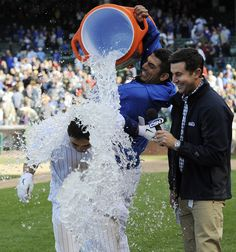 Matt Garza dousing Darwin Barney in ice water after a walk off two run homer to win the game in the 9th. Darwin said it best - there's a lot of season left to play. Who knows? :)