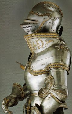 The famous 'KD' armor (part of a large garniture) was made for CharlesV (later Emperor of the Holy Roman Empire) in Augsburg in 1525 and is attributed to Kolman Helmschmied. Featured on the upper breast -and backplate is an etching of the: Order of the Golden Fleece. Part of an incredible rich collection, this armor is part of the Patrimonio Nacional, and can be seen at the: Armeria Real de Madrid/Spain.