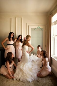 I love the dress on the bridesmaid in the back with the brown belt and pink tulle.