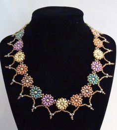 Lovely Necklace bead woven in summer hues ranging from yellow to purple. It is made with Czech beads, Japanese seed beads and Swarovski crystals. Fit for any summer occasion.