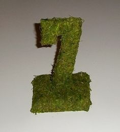 Moss Table Numbers, Wedding Table Numbers, Reception Table Decorations. $8.00, via Etsy.