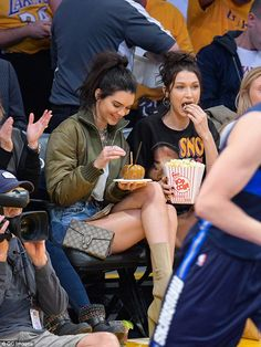 Tucking in: The models tucked into game day treats without hesitation