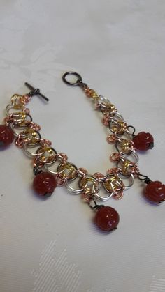 Multi colour chain mail bracelet with carnelian 10mm beads