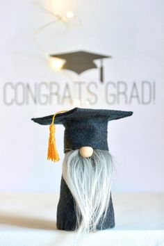 This graduate is looking good in his cap and gown! Nordic Gnome Graduation Gnome, Tomte, Nisse, Fun Graduation Gift, Grad Present