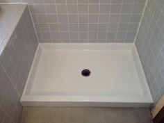 shower pan by miracle method protective masking removed buffed polished recaulked and