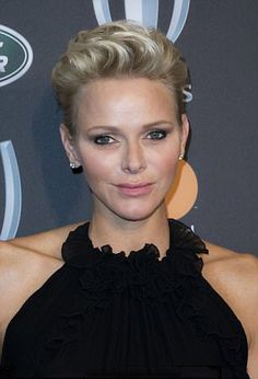Princess Charlene of Monaco topped off her glamorous look with diamond earrings. The high-collared frock featured ruffled detailing at the collar, as she attends to the World Rugby Awards at the Monte-Carlo Sporting in Monaco
