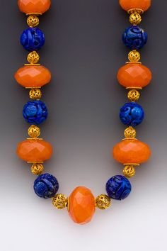 Duet  Extra-large - royal, even - faceted carnelian rounds interspersed with large 18K gold filigree beads & deep blue afghani lapis lazuli, carved in the Chinese -style. Large 18K safety clasp.