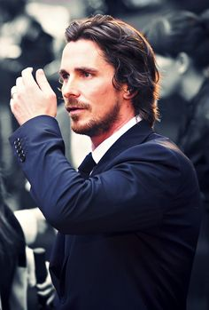 Christian Bale.- No need to fix your hair there Mr.Bale!!
