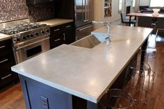 white concrete countertops from j aaron, via houzz