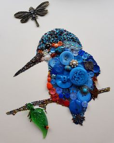 Kingfisher using buttons, rhinestones, charms and the inclusion of a beautiful handmade glass leaf and ladybird by Sue of Glitterama Crafts, as featured on Etsy.