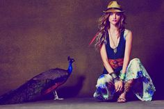 Peacock, fedora and feathers... bohemian soul alright.