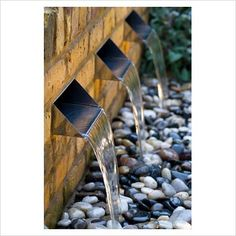 GAP Photos - Garden & Plant Picture Library - Water feature with three rills and pebbles - GAP Photos - Specialising in horticultural photography