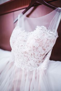 So many amazing details on this delicate lace and tulle wedding dress with…