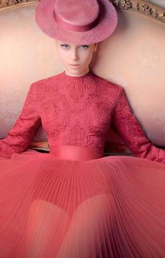 Christian Dior. Salmon pink. Pleated skirt. Hats with ribbons.