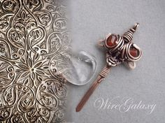 Sword pendant by WireGalaxy on Etsy