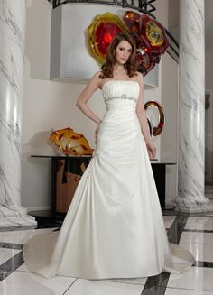 Strapless Ivory Wedding Dress of 2011 MBD7544 This spring 2011 dress features bateau neckline, pleated bustier, with silver beading sash acc...