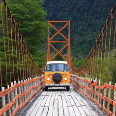 Tango Orange VW Camper van bus, crossing the bridge.