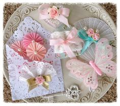 For your crafting pleasure Ive put together a parcel of the prettiest embellishments in my studio.  paper lace envelope filled with crepe paper
