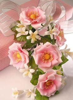 Arranjo de flores de biscuit
